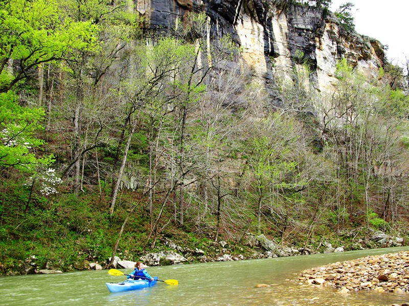 A kayaker paddles down the Buffalo National River.