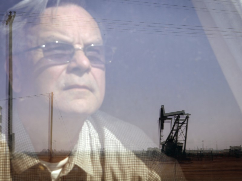 Kern County resident Walt Desatoff gazes at an oil derrick.