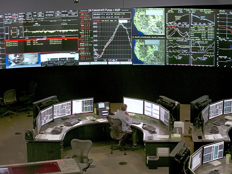 A worker at the California Independent System Operator grid control center in Folsom, Calif., monitors the state's energy grid in 2017