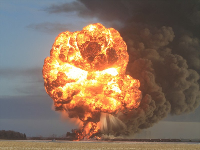 Fire from petroleum crude oil tank car explosion.