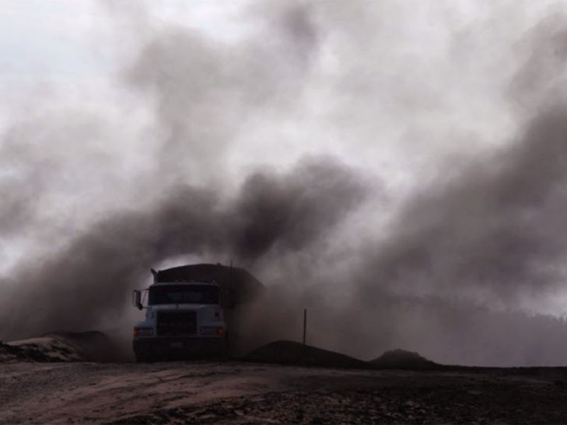 Toxic coal ash dust at the Making Money Having Fun Landfill in Bokoshe, OK.