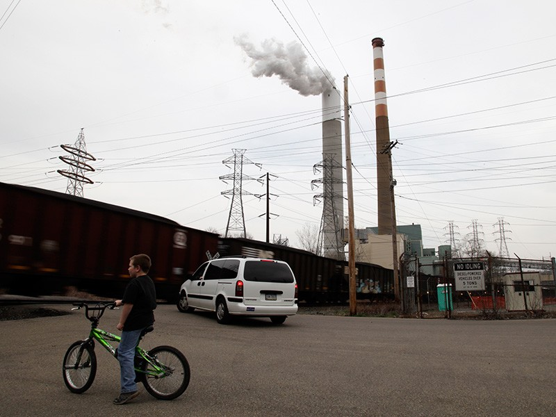A child plays near the Cheswick coal-fired power plant in Pennsylvania. Burning coal is a major cause of climate change and releases toxic pollution that threatens our air and water.