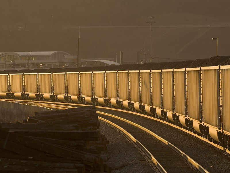 Loaded coal hoppers at sunset.