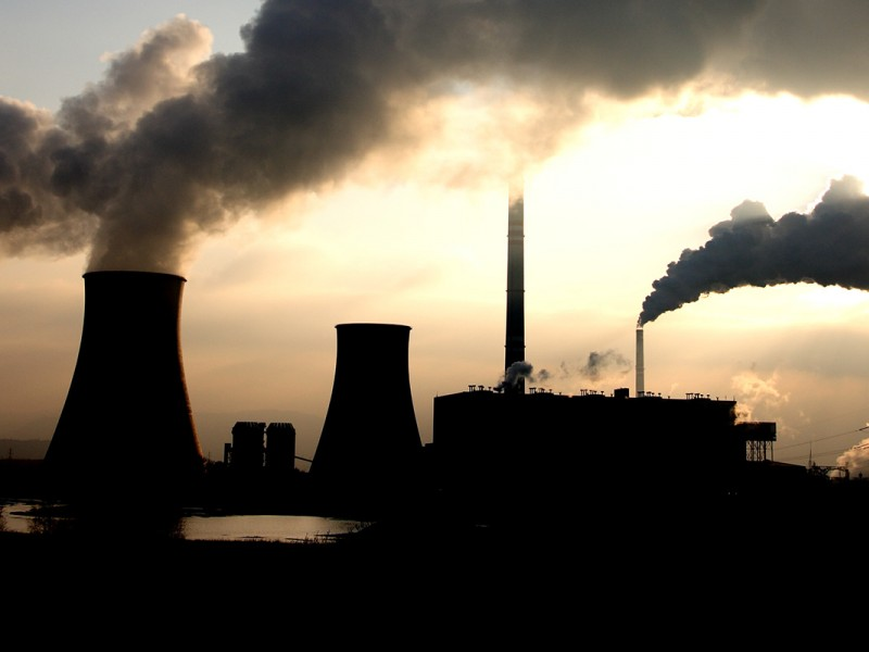 The sun breaks through smoke from a coal-fired power plant.