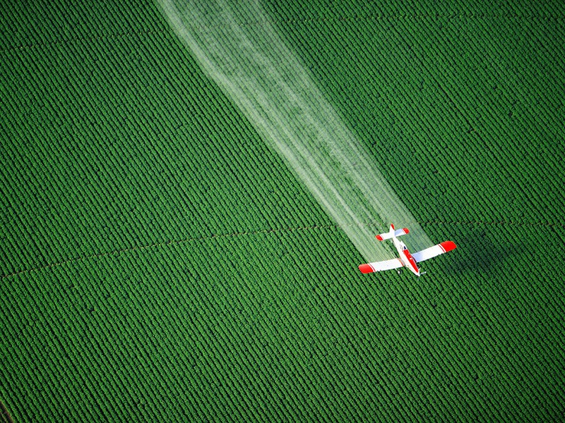 A cropduster sprays agricultural fields.