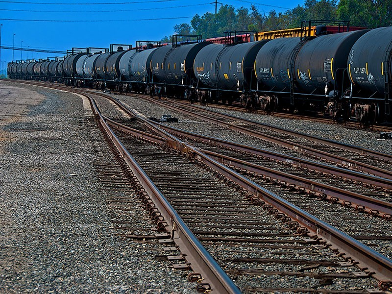 An train carrying oil travels through California.