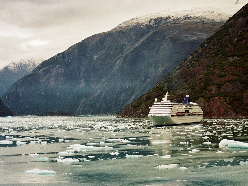 Cruise ship at Alaska's Tracy Arm Fjord. The ships dump wastewater into Alaskan coastal waters and leave partially-treated sewage, heavy metals and chemical pollutants in their wakes.