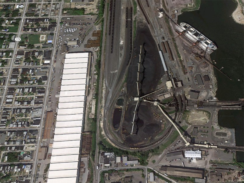 The CSX coal export and processing facility in Baltimore, MD. Neighboring communities already suffer from air and noise pollution generated by the rail traffic and facility operations.