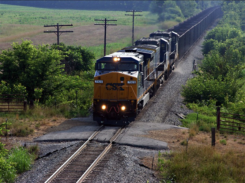 A CSX coal train travels through Evansville, IN. Coal trains generate huge volumes of toxic dust as they travel from the country's interior, disrupting and polluting communities.