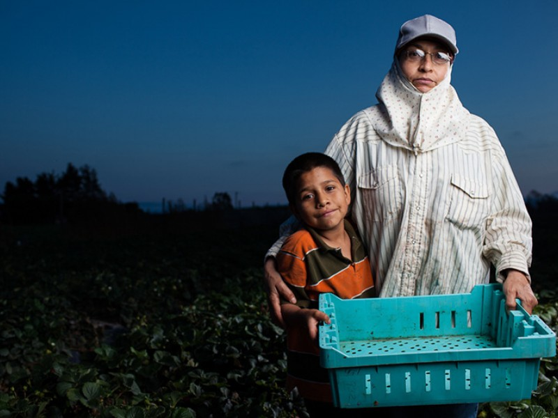 Maria, a farmworker for more than two decades, stands in a California farm field.