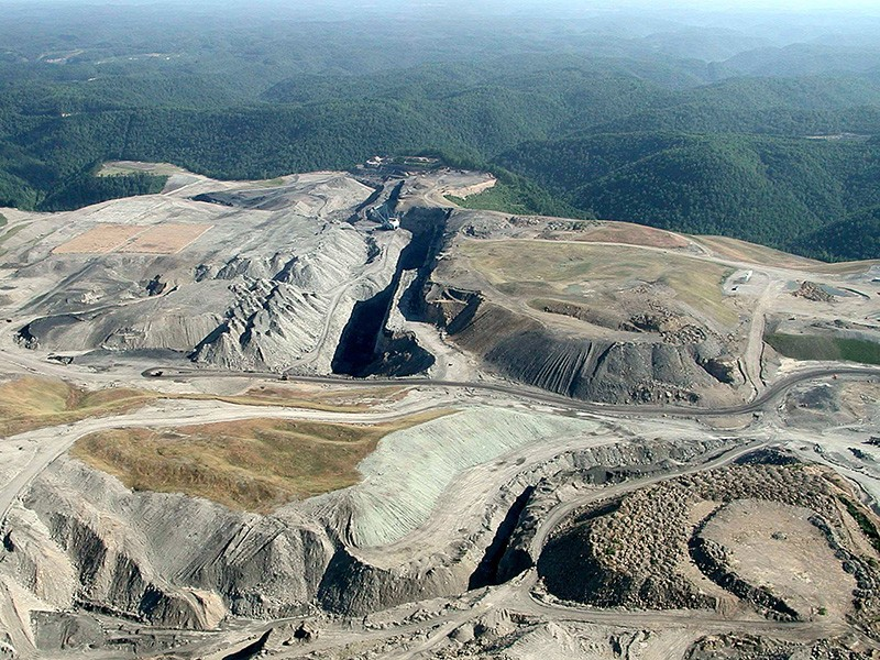 Mountaintop removal coal mining devastates the landscape, turning areas that should be lush with forests and wildlife into barren moonscapes.