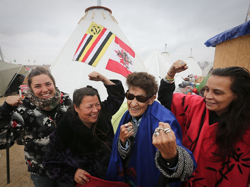 Taylor Peterson, Katherine Morrisseau, Nancy Scanie, and Fawn Youngbear-Tibbetts. Clan Grandmother Nancy Scanie from Cold Lake Dene First Nation in Alberta Canada represents the Athabasca Keepers of the Water.