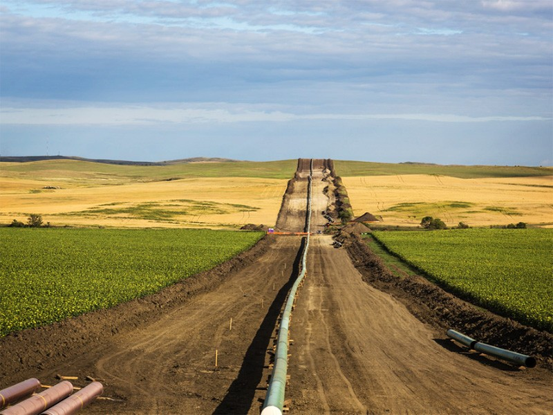 The DAPL (Dakota Access Pipeline) being installed between farms, as seen from 50th Avenue in New Salem, North Dakota.
