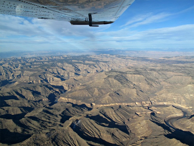 An airplane passes over Desolation Canyon, UT.