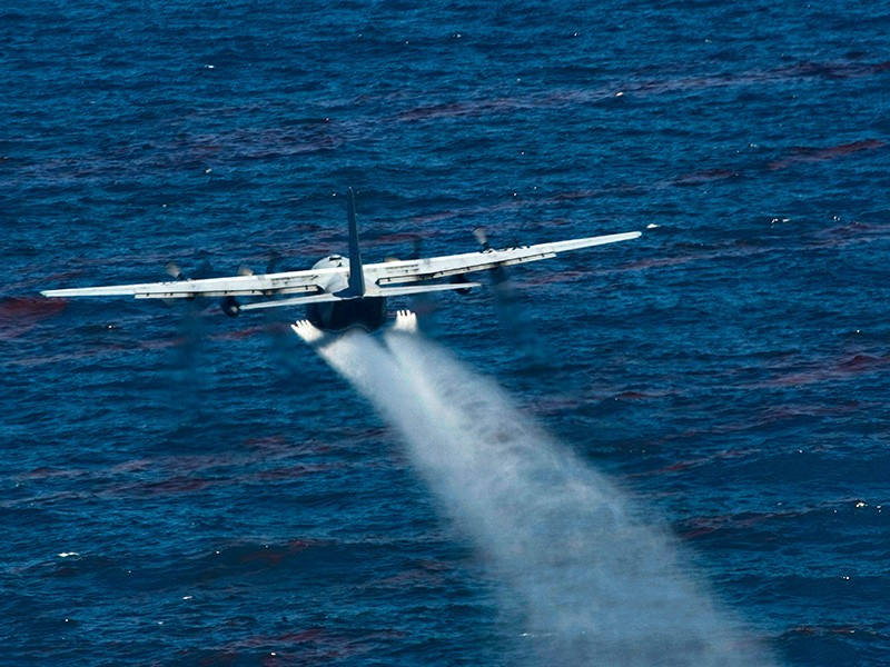 A U.S. Air Force aircraft drops an oil dispersing chemical into the Gulf of Mexico as part of the Deepwater Horizon Response effort on May 5, 2010.