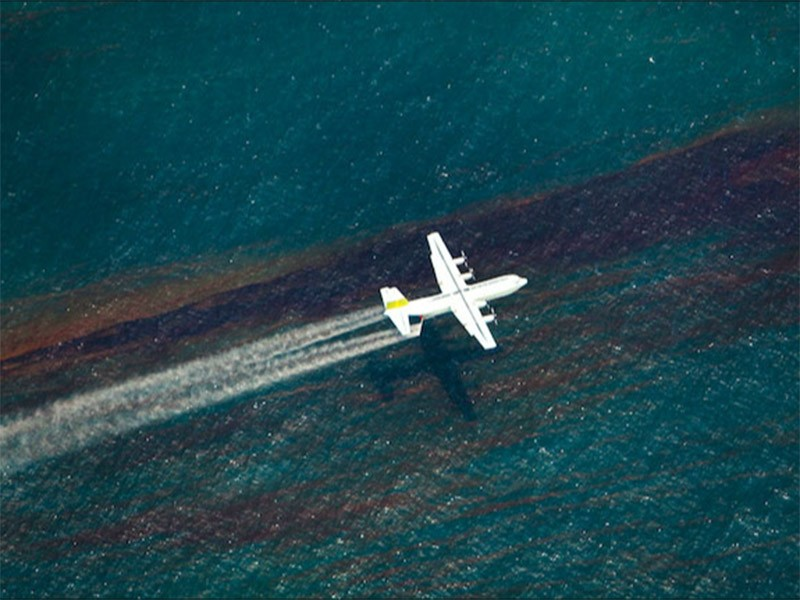 A chemical dispersing aircraft flies over the Gulf of Mexico, during the BP Deepwater Horizon oil spill.