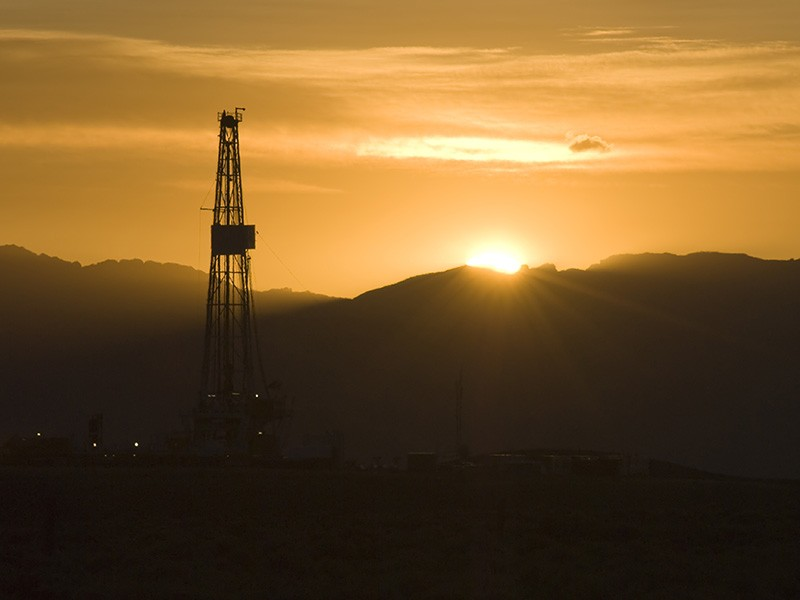 A drill rig at sunrise.