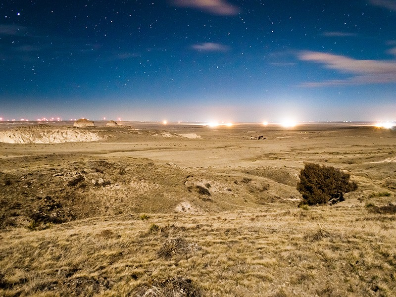 Drill sites light up the evening sky in Pawnee National Grasslands, Colorado.
