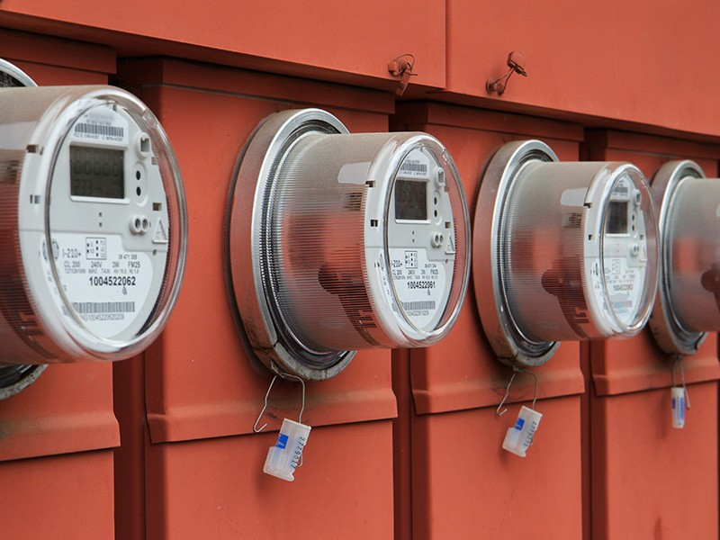 A row of electrical meters.