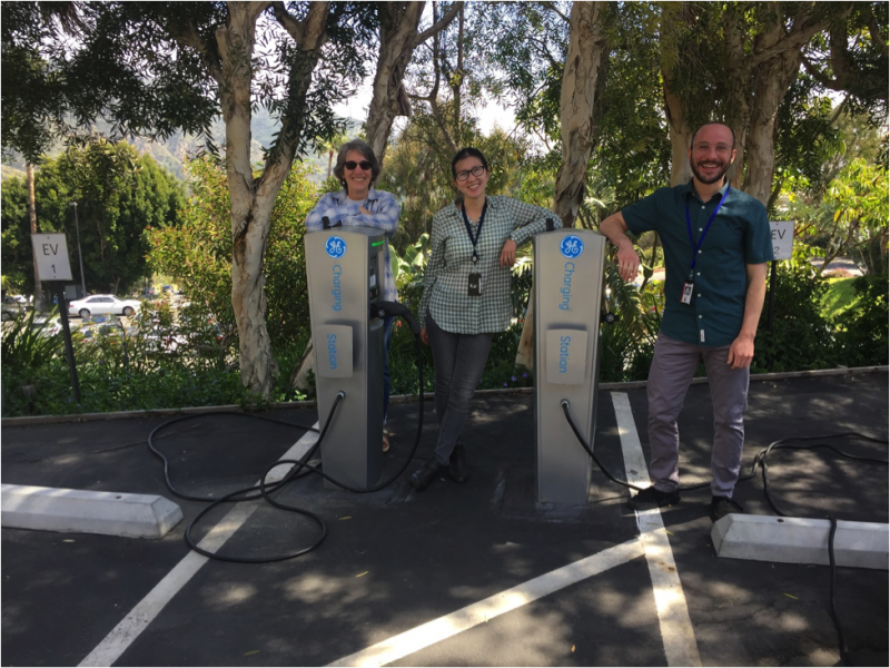 Electric car drivers Stephanie Tiffany, Shanying Cui, and Ari Weinstein (from left to right) purchased their vehicles after their workplace installed charging stations.