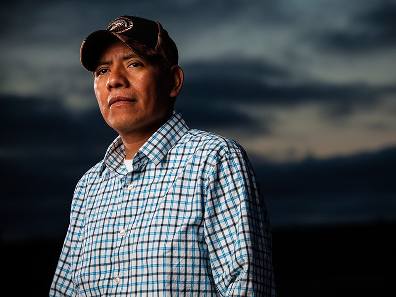 Pedro Reyes teaches English to farmworkers to help improve farmworker protection standards.