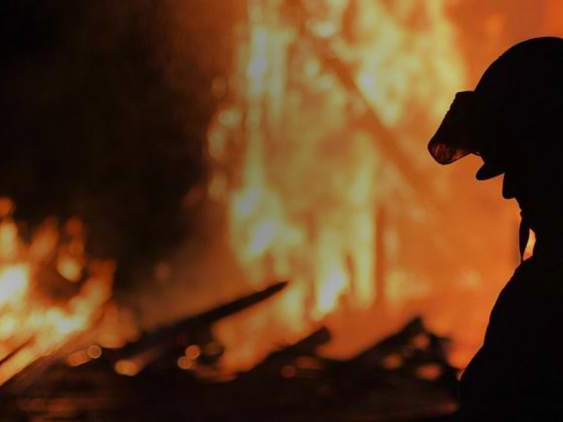 Silhouette of a firefighter.