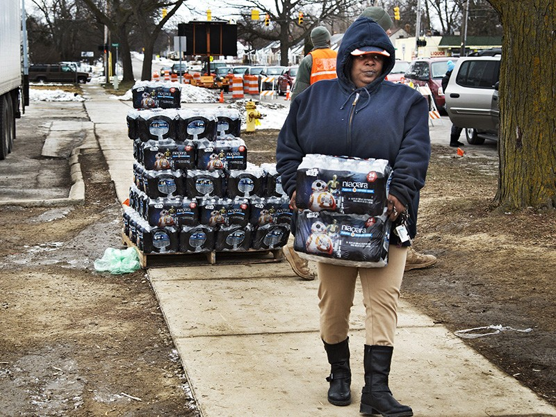 Bottled water distribution by National Guard at Fire Station 6, in downtown Flint, Michigan, on January 23, 2016.