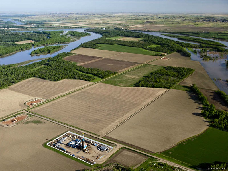 A drill rig and well pads in a floodplain, near the confluence of Missouri and Yellowstone Rivers.