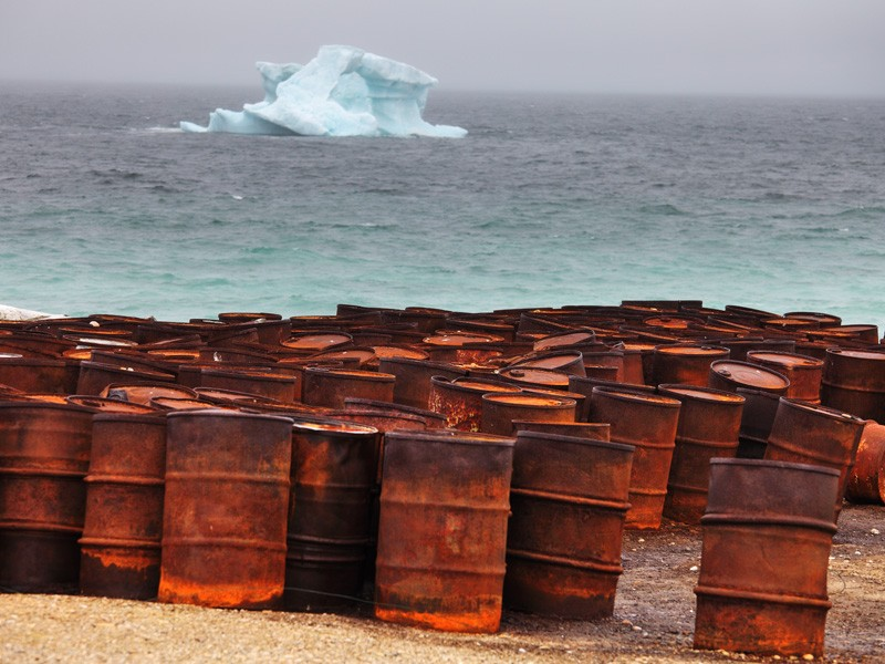 Abandoned oil drums rust on the Arctic coast. There is a 75 percent risk of one or more large oil spills in the Chukchi Sea if these leases are developed.