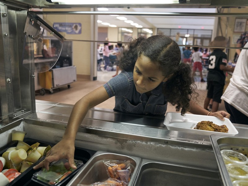 A student chooses among lunch options at East Brainerd Elementary School in Chattanooga, Tennessee.