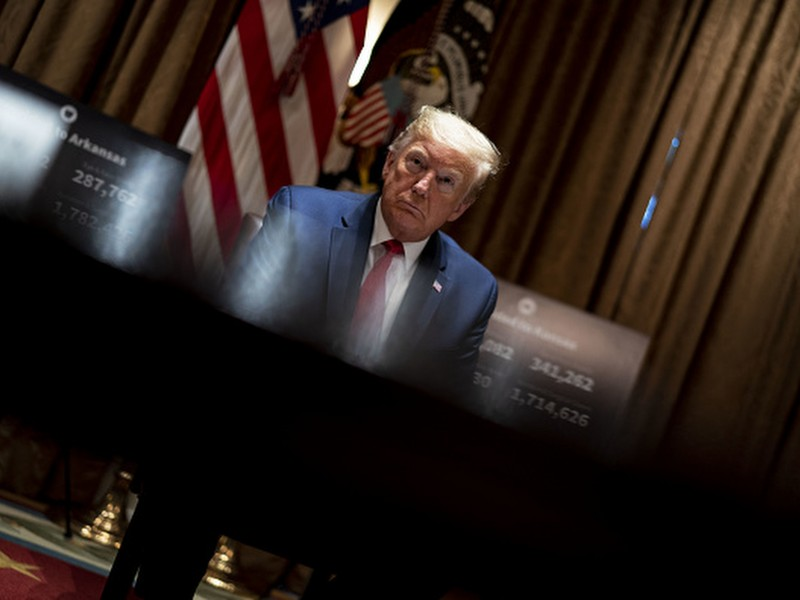 President Donald Trump pauses during a meeting in the White House on Wednesday, May 20, 2020.