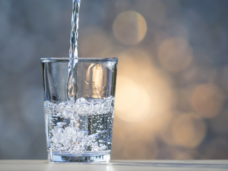 Water is poured into a drinking glass.