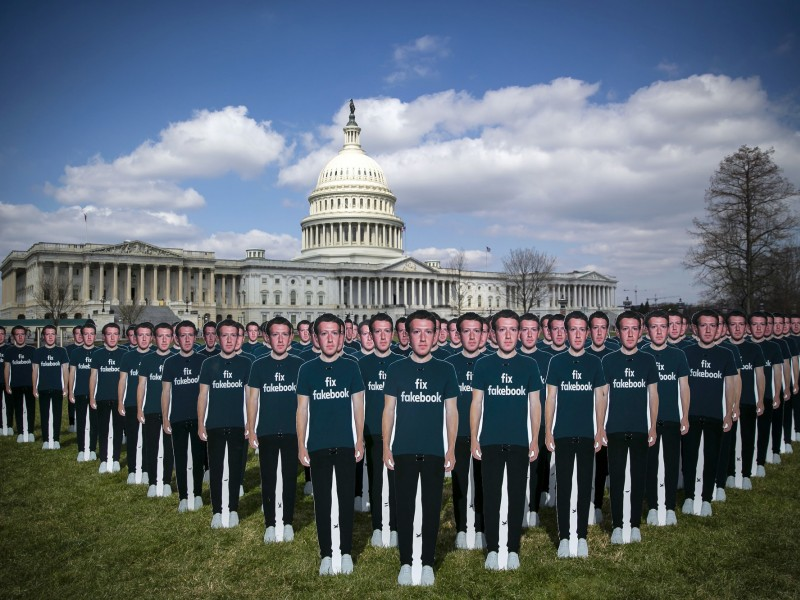 Cutouts of Facebook CEO Mark Zuckerberg are displayed on the South East lawn of the Capitol building