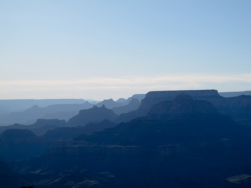 Haze obscures a view of the Grand Canyon.