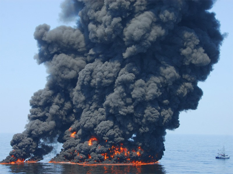 A controlled burn of oil from the Deepwater Horizon / BP oil spill sends towers of fire hundreds of feet into the air over the Gulf of Mexico on June 9, 2010.