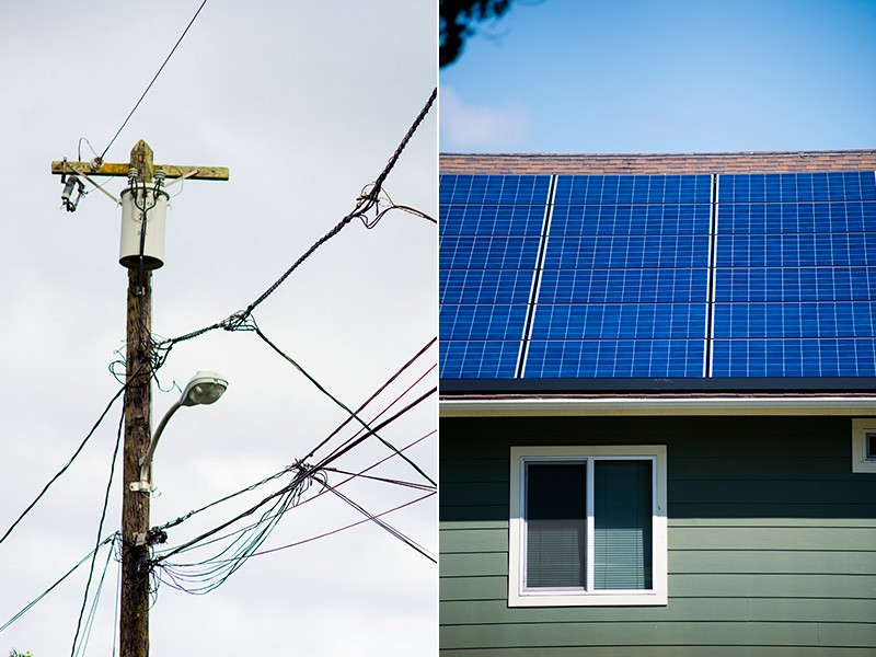 Powerlines and rooftop solar panels in Oahu, Hawaii.