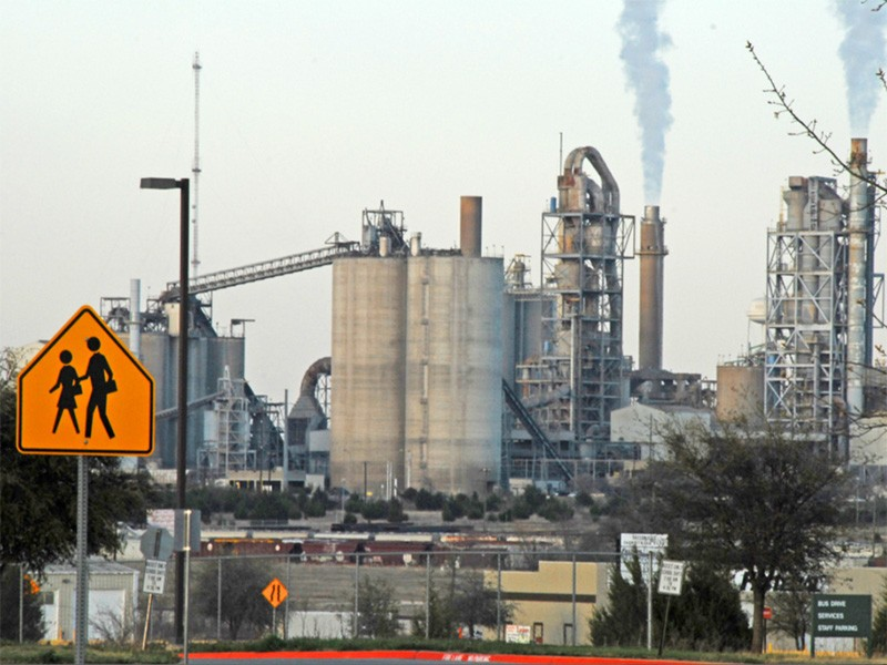 An industrial incinerator, as viewed from a church playground in Midlothian, Texas.