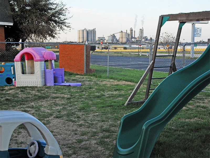 An industrial incinerator frames a church playground in Midlothian, Texas.