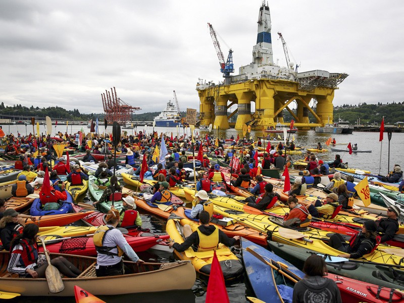 """Activists who oppose Royal Dutch Shell's plans to drill for oil in the Arctic Ocean prepare their kayaks for the """"Paddle in Seattle"""" protest in May 2015, in Seattle. These initial protests have sparked similar #ShellNo kayaktivism around the U.S."""