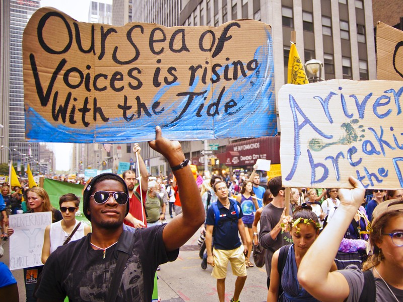 Marchers in New York City's 2014 Peoples Climate March. Heightened activism at the local level has garnered a breakthrough for environmental justice in this city.