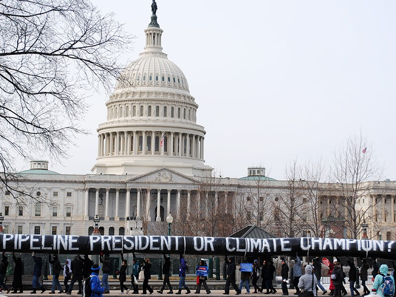 Concerned members of the public from 350.org and other organizations carry a 200-yard inflatable pipeline around the Capitol Building in 2014, demanding that the President Obama reject the Keystone XL tar sands pipeline.