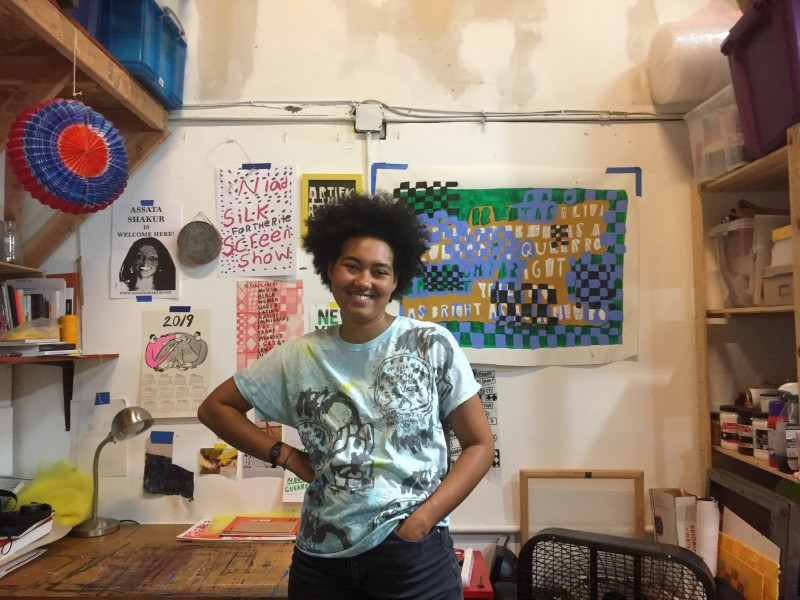 Activist and artist Lukaza Branfman-Verissimo stands in her Oakland studio.