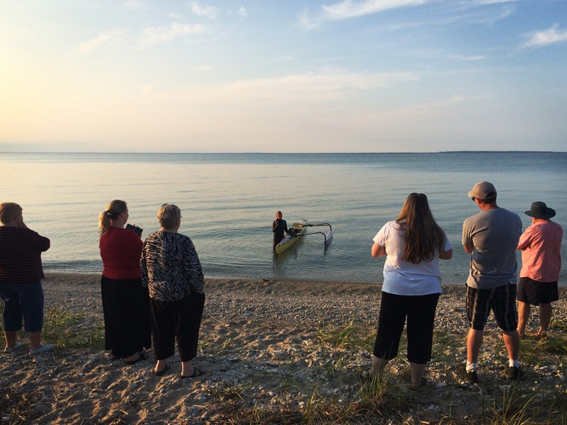 Margo Pellegrino comes ashore in Wilderness State Park in Michigan to take a day off from her journey where she is greeted by family.