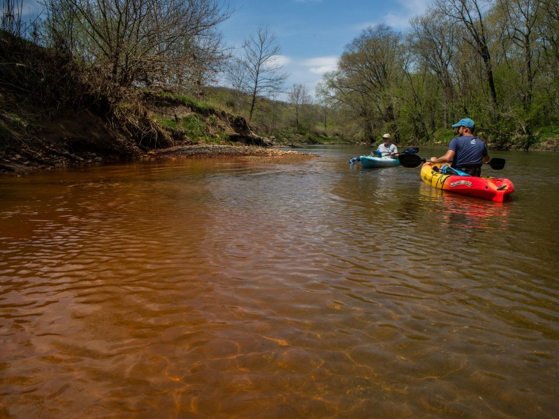 Andrew Rehn, right, of the Prairie Rivers Network and Lan Richart of Eco-Justice Collaborative paddle past toxic coal ash waste seepage on the Vermilion River in Illinois.