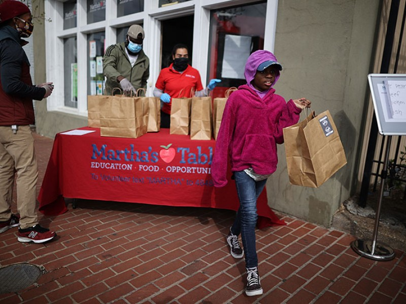 Volunteers at a nonprofit in Washington, D.C., distribute free hot meals during the COVID-19 pandemic.