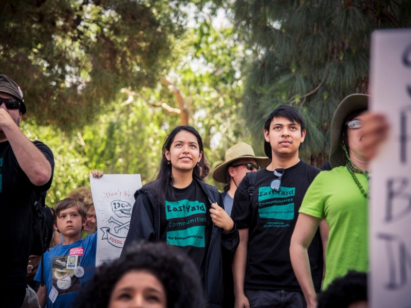Kimberly Amaya, center, marches with other members of East Yard Communities for Environmental Justice.