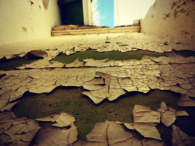 Peeling paint in an old building.