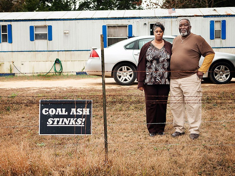 Annette Gibbs and her husband William stand in their front yard, near the Arrowhead Landfill in Perry County, AL.
