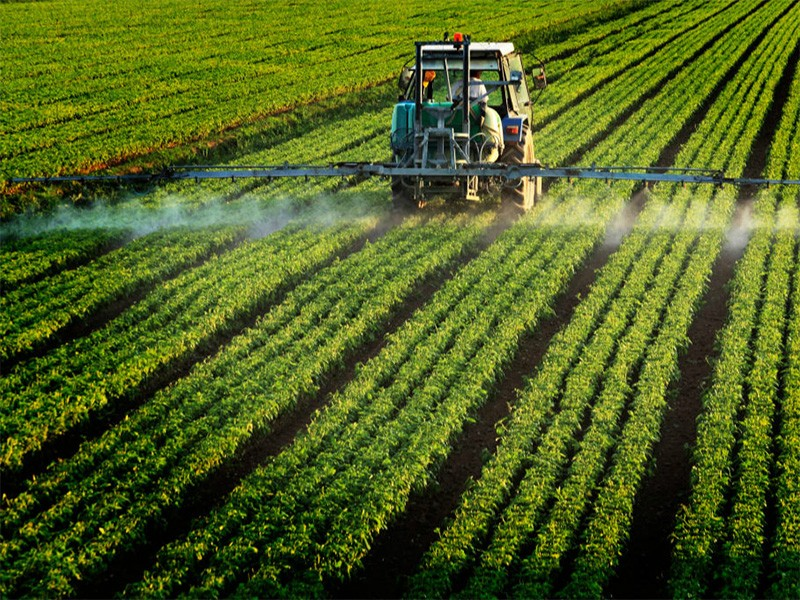 Pesticides being applied to a farm field.