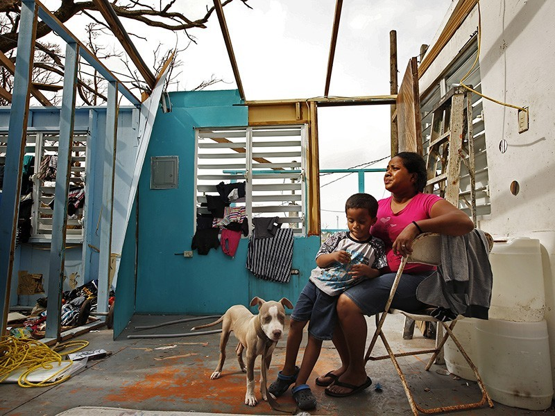 Heydee Pérez and her son, Yenel Calera, a week after hurricane Maria hit Puerto Rico.